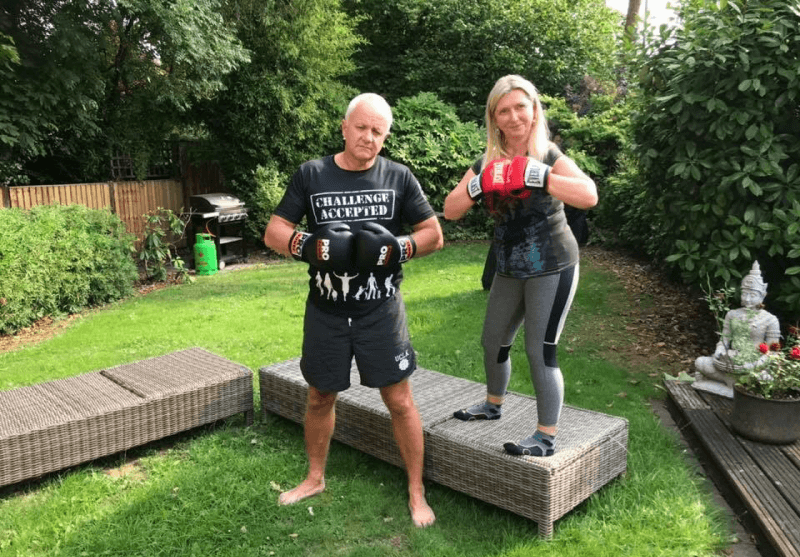 two people in personal training session with boxing gloves